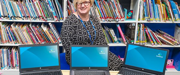 Alison Benge (Head of School, Mount Pleasant Primary) with computers donated by Connexus