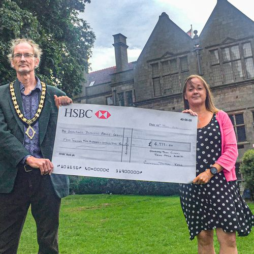 Oswestry Mayor Cllr Duncan Kerr present a cheque to Wendy Bulman, Domestic Abuse Support Service Manager